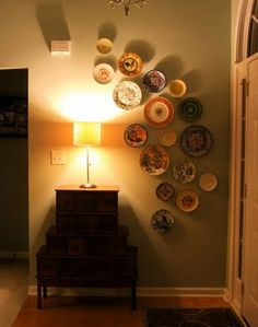 plate wall.  looks even better at night.  Used in foyer. Even better with an interesting set of drawers like these.