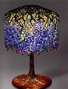 Louis Comfort Tiffany - Stained Glass work Tiffany Studios American (firm active Wisteria table lamp, c. 1902 leaded glass and bronze Lillian Nassau Ltd., New York Tiffany Glass, Tiffany Art, Tiffany Stained Glass, Stained Glass Lamps, Leaded Glass, Mosaic Glass, Tiffany Jewelry, Tiffany Blue, Art Nouveau