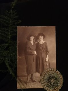 Snazzy dressers from an earlier age! Photo measures 3 1/2 x 5 1/2. Sepia tone . Back has glue residue from being in an album . There is a