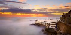 Beautiful Sunrise at Bronte Baths, Bronte Beach, Sydney, NSW, Australia. Bronte beach at the Bondi to Coogee walk and is great for swimmers and surfers alike. Bronte Beach is very scenic it makes for a nice getaway for the whole family. Bronte Beach is popular with surfers despite the often rough surf. You can swim at the 'bogey hole', a 30 metre ocean pool rock pool towards the southern end of the beach if you find the surf too challenging. Bondi to Bronte walk is one of the most popular…