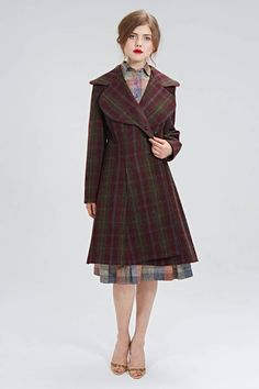 "40s style checkered wool coat.""Dorothy"" coat is made of of beautiful wool tartan fabric. Closes front with hidden buttons. Silhouette Double breasted coat with oversized round collar and side pockets. The coat is fully lined. Colors: green, red, blue, mustard yellow. Mrs Pomeranz is a premium ladies wear clothing brand, based in London and Moscow. Specializing on a particular style of dresses and skirts, based on the classical 50's silhouette. Production is kept relatively small, allowing…"