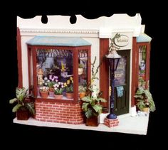 """Dollhouse Miniature 1/12th Scale - Botanica Flower Shop_Exterior Constructed by Linda Novak 1990 Part of """"The Street of Shops"""" series."""