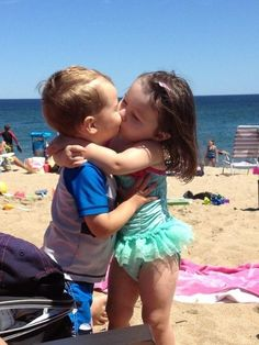 Hot and Heavy Gills C. from North Reading, Massachusetts sent in this photo of her grandson and a friend's daughter getting to know each other on the beach!