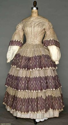 PURPLE PRINT VOILE DRESS, c. 1850 Triple tiered skirt & bell sleeves printed en disposition, bodice w/ small purple dot print & fan front, embroidered white cotton undersleeves basted into bell sleeves Clothing And Textile, Antique Clothing, Historical Clothing, Historical Society, 1850s Fashion, Victorian Fashion, Vintage Fashion, Farm Fashion, Vintage Dresses