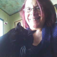 """Throwback photo of me and my sweet Leia. She was ready to join her life long """"sibling"""" Luke back in February. Still smell her presence in my room. It is comforting. It was a terrible painful end to her journey (constipation and blocked anal canal) exasperated by the unkindness of a vet who put her to rest. (He's since been charged with animal abuse in other cases.) Her fur was like velvet and she didn't say much except the odd peep.  #cats #blackcats #catsofinstagram #oldercat…"""