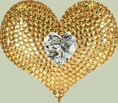 A BIG GOLD HEART WITH A DIAMOND HEART IN THE CENTER.