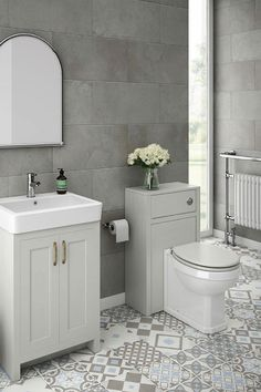 How would a modern traditional grey bathroom look in your home? This exquisite small grey bathroom features the Chatsworth light grey bathroom vanity cabinet and matching WC unit. Traditional bathroom ideas like the Moroccan bathroom floor tiles, traditional heated towel rail and bathroom wall mirror add to the stunning decor. Click the image for more information.
