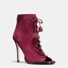 543246a8dba001 Edgy collides with sweet on this Victoriana-inspired lace-up design,  beautifully crafted in velvety suede with delicate leather buds at the lace  ends.
