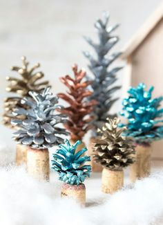 Plain pinecones can be transformed into a beautiful Christmas tree forest. The painted pinecone looks frosted glass, don't you think? Cork Christmas Trees, Christmas Tree Pictures, Pine Cone Christmas Tree, Beautiful Christmas Trees, Christmas Crafts, Merry Christmas, Wine Craft, Wine Cork Crafts, Pine Cone Decorations