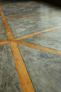 I think this flooring is a really interesting way of using wood and concrete side by side. fatelondon.com
