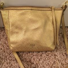 PRICE CUT!! Brand New Fossil Bag BRAND NEW. NEVER USED. Gold Crossbody with dust bag. Fossil Bags Crossbody Bags