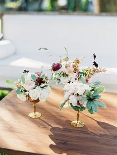 The most gorgeous floral arrangements! Vibrantly romantic in shades of ivory, blush and pops of magenta.