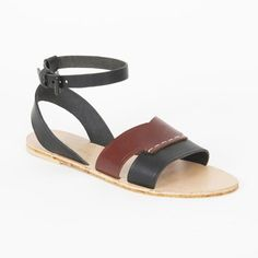 Two-tone chunky strap sandal with thin ankle strap + matte black buckle hardware. -Natural, lightly pebbled soft black leather with smooth, luxurious british tan leather upper-Adjustable ankle strap-Natural vegetable tan leather insole + outsole-Stitched with waxed linen thread-100% leather with rubber heel  Handmade