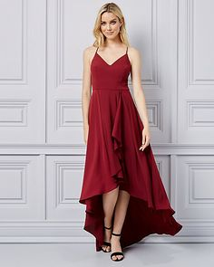 V-Neck High-Low Gown - A feminine gown you can wear with confidence is fitted with an alluring v-neck, strappy back and effortless flowy skirt. High Low Gown, Flowy Skirt, Confidence, Feminine, V Neck, Gowns, Holiday, Skirts, How To Wear