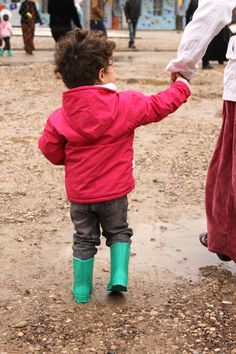 Spirit of America reps were able to provide a pair of rubber boots to this little girl at a temporary housing site in Iraqi Kurdistan. #ISIS #refugees #Iraq #Kurdistan #Erbil #SpiritofAmerica #SoA #children #boots #girl #winter