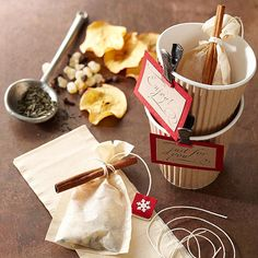 This thoughtful tea kit is a great Christmas gift for those who love hot drinks on cold, wintry days. Ginger, cloves, and dried apple chips flavor the warming homemade tea mixture. Simply fill tea filters with the premade mixture, wrap with string to close, and tie on a cinnamon stick or two. Festive tags and cups finish the project.  /