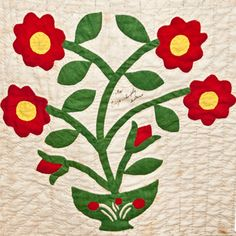 Traditional applique was often very stylized with shorthand indications of florals. The eight-lobed flat flower with a circle in the center is the classic 19th-century applique. Circles or dots usually stood for a fruit as in the bowl here.
