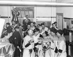 Art Fletcher, Marvin Breuer, Earle Combs, Johnny Murphy, Phil Rizzuto, Red Rolfe, Tommy Henrich and Johnny Sturm of the New York Yankees celebrate in the locker room after the Yankees defeated the Brooklyn Dodgers in Game 5 of the 1941 World Series on October 6, 1941 at Ebbets Field in Brooklyn, New York.