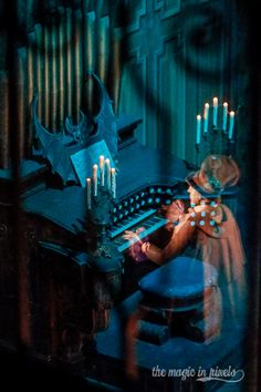 """The Haunted Mansion Organist""  The spirited organist from The Haunted Mansion plays a ghostly refrain for the guests in the ballroom.  ..."