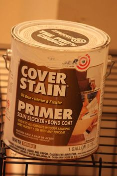 It is an oil based primer by Zinsser I found at Lowes that STICKS TO ALL SURFACES WITHOUT SANDING! And without stripping, because you can't strip wood veneer. Plus, you can put anything on top of it. It doesn't have to be an oil based paint. It just gives you a beautiful blank canvas.