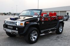 Hummer H2 tuning -- cool concept, but I could do without the tribal vinyls... those are for the birds...