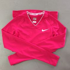 "✨NEW LISTING✨ Nike Dri-Fit Long Sleeve Shirt This fits tight like a compression shirt. I love it and am parting with it because my biceps outgrew it...gains, right? :p Anywhos, it's hot pink, a little longer than average, and has a cool feature lining the bottom that make it slightly ""stick"" to the skin: just keeps it from doing that annoying riding up thing while running/lifting. Looks brand new! Nike Tops"