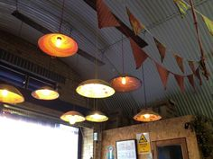 Basket style lampshades, strings of flags inside Brixton brewery.