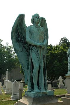 Male angel statue    Greenmount Cemetery, Baltimore.