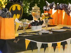 Batman Birthday Party #batman #party lots of it can be bought at walmart/dollar store: black and yellow table cloths, plates, paper bags....