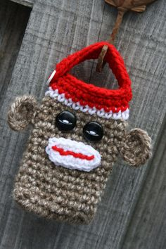 Sock monkey cell phone, iPhone holder case cover cozy crochet in red, brown & white with black button eyes.