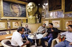 An enormous bust of Umm Kulthum decorates a coffee shop in downtown Cairo where her music, and much animated conversation, fill the air.