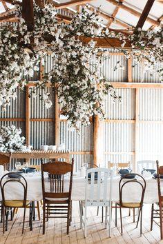 Mismatched chairs and hanging florals