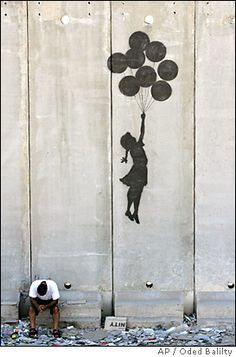 one of the greatest guerilla graffiti artists to ever live....banksy, he painted this on the Palestine/Israel segregation wall