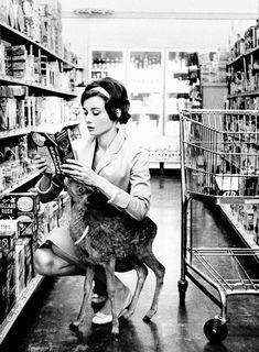 1958: Audrey Hepburn grocery shopping with her deer. (fun fact: the pet's name is Ip, short for Pippin) By Bob Willoughby