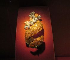 Orange Peel Brooch, 2001; Garnets, diamonds, enamel, silver, gold; private collection. Photo credit- Anthony DeMarco