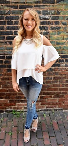 """This beautiful white colored top is made of a flattering, flowy material. It is very easy to dress up or down, as we have it pictured with white jeans and wedges for a more formal look, and with white denim shorts and sandals for a more casual look. We also have this gorgeous top in Royal Blue, Green & Orange.     *Fits true to size; Model is 5'2"""", wearing a size small* -11344 W-     100% polyester; Hand wash in cold, hang to dry"""