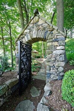A beautiful stone arch greets you on the path to your private tennis court. Ah, the good life!