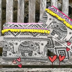 Bohemian Aztec Elephant makeup bags , purses , clutches with pom poms now in shop.