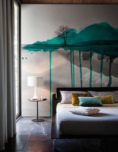 Spun Light by Sebastian Wrong adds a warm glow to this unique modern bedroom with brightly colored walls.