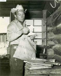 Cowboy at heart and Levi's-lover Bing Crosby opening the mail bag at his ranch in Elko, Nevada. #earnestsew