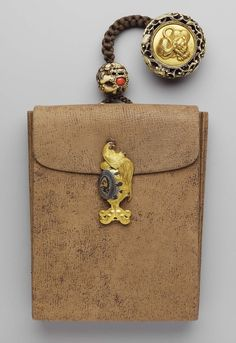 Tobacco-pouch; kagami netsuke with design of a tiger; kanamono in the form of a cockerel on a drum symbolizing peaceful and just government (kankodori); netsuke in the form of a shishi and ball | Museum of Fine Arts, Boston