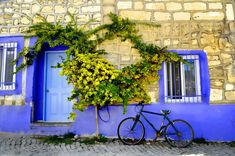 with vibrant blue Amazing Places On Earth, Beautiful Places, Golden Coast, Bike Shed, Traditional Doors, Holiday Mood, Secret Places, Famous Places, Simply Beautiful