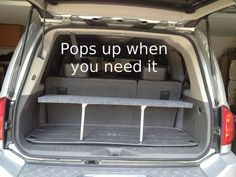 SUV pop-up shelf for the cargo area.  Folds down when not in use, can hide valuables under, and segregate items when needed.