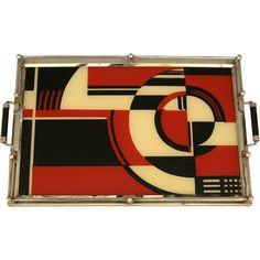This is the iconic 1930's Jazz Cocktail tray. Pictured in many Art Deco reference books over the years and held in several museum collections, this tray epitomizes the bold graphic designs of the early 1930's. It is made of silkscreened glass with metal and wood trim.