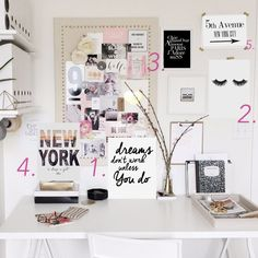 wall gallery desk decor office decor for blogger with lots of prints on the wall