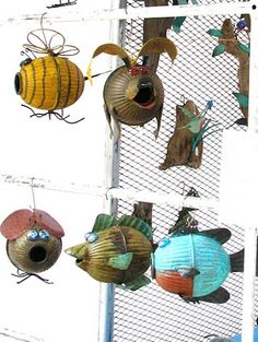 made from old toilet floats; genius!- I actually love the bee one....he might have to find a spot near my garden...