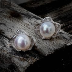 Pure silver 92.5 pearl studs with a very good finishing and design #silver #silverjewellery #pearls #pearljewellery #zirconiastones #studs #silverstuds #beautifulearrings #silverstore #pearlearrings #silverornaments #pearlstuds #earringswithpearls #stonedearrings #earringswithstone