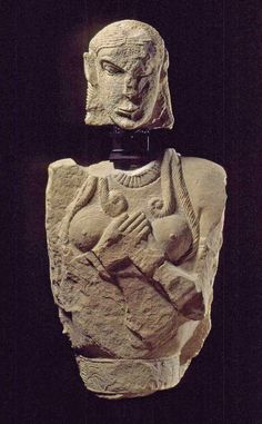 Pietrera tomb,Vetulonia.Italy. almost life-size free-standing limestone statue, one of the oldest stone sculptures in Etruria. Her costume and her hair in loose plaits running over her shoulders and breasts is found only in Etruria and reflects Etruscan custom, while the position of her hands was found also in the Near East, ca. 625 BCE