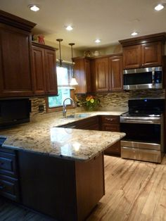 Kitchen makeover with cherry cabinets (coffee color), granite and glass-natural stone back splash., Kitchen makeover main view., Kitchens Design