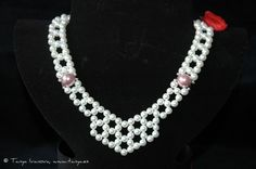 Pearls necklace, as it looks at its frontal part.